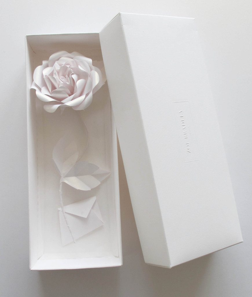 3-BOXED PAPER ROSE STEM WITH GIFT CARD IN WHITE GOLD BY ZOE BRADLEY . ALSO AVAILABLE IN PINK, LILAC AND RED. Represented at London Craft Week by Crafted.