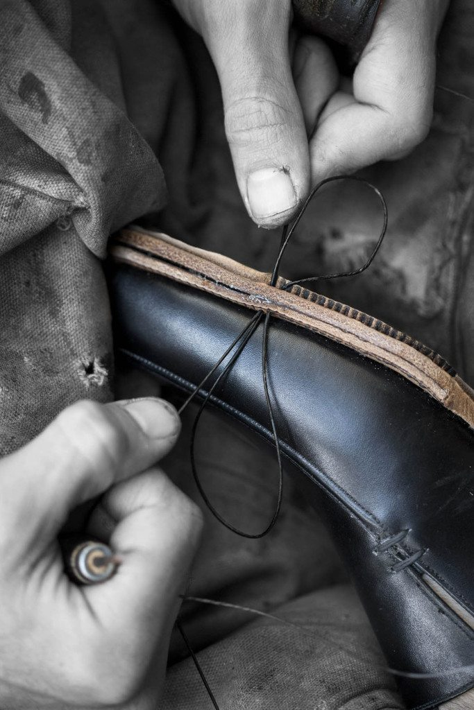 Stitching sole - Process 111 of the 200+ steps in making handsewn shoes - stitching the soles using only an awl, waxed hemp thread and bristles, at Carreducker